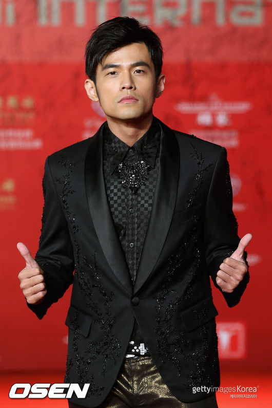 SHANGHAI, CHINA - JUNE 15:  Taiwanese singer, actor and director Jay Chou arrives at the opening ceremony of the 16th Shanghai International Film Festival at Shanghai Culture Square on June 15, 2013 in Shanghai, China.  (Photo by Feng Li/Getty Images)